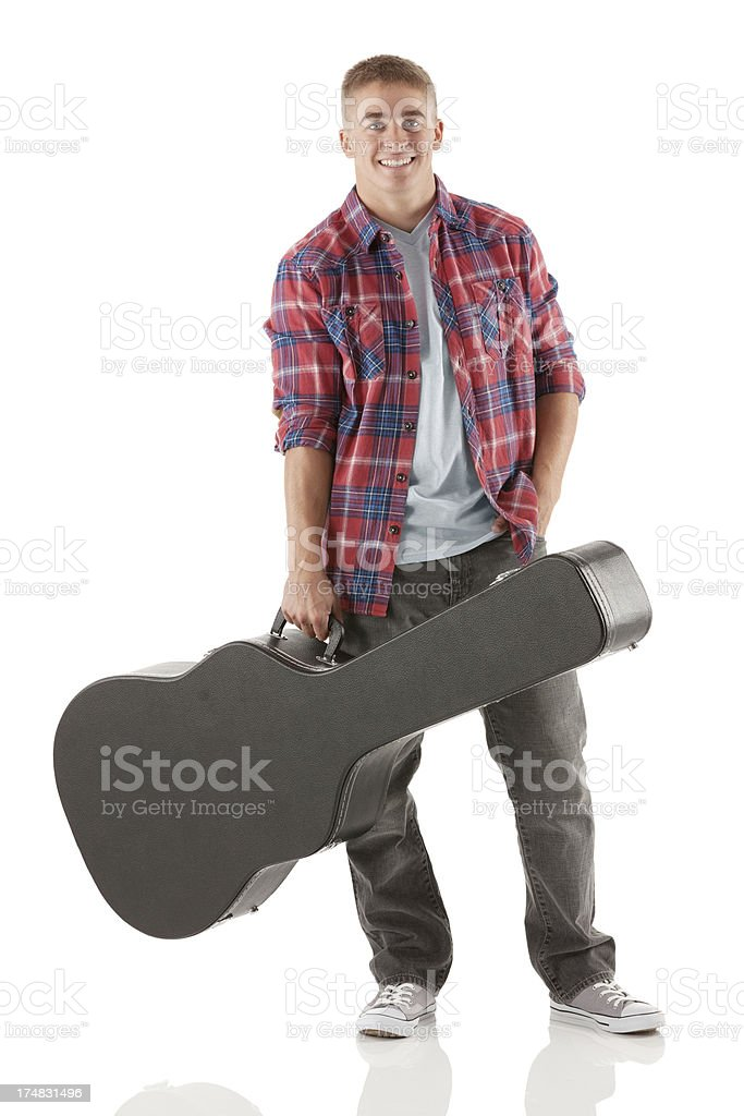 Man standing with guitar case royalty-free stock photo