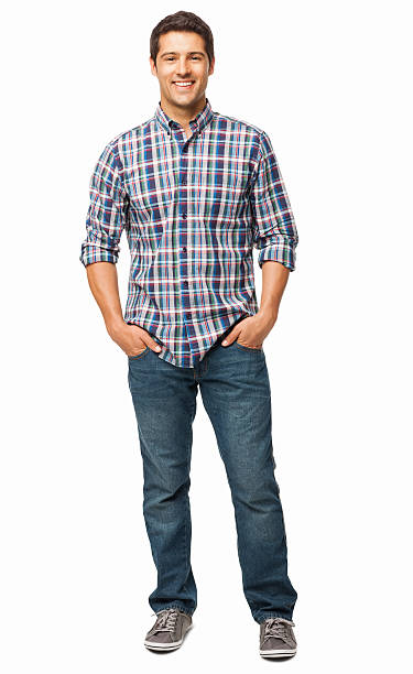 man standing with hands in pockets - isolated - casual clothing stock photos and pictures