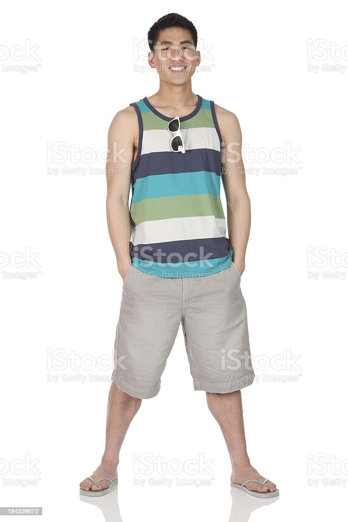Man standing with hands in pockets stock photo