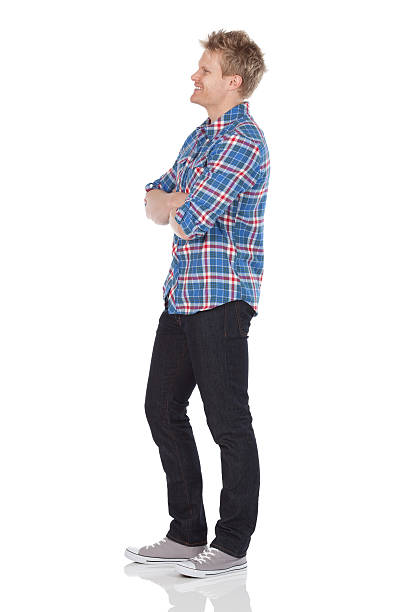Man standing with his arms crossed stock photo