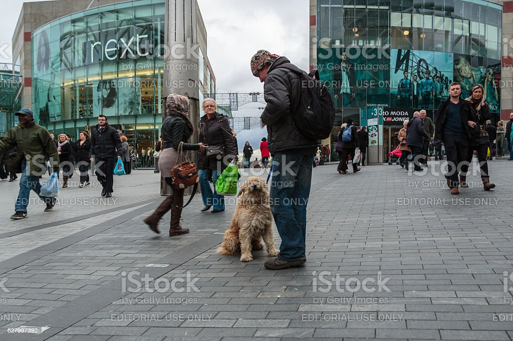 Man standing with his dog in city centre stock photo