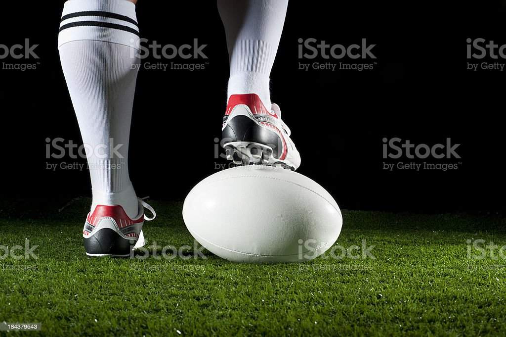 Man standing with his foot on a ruby ball stock photo