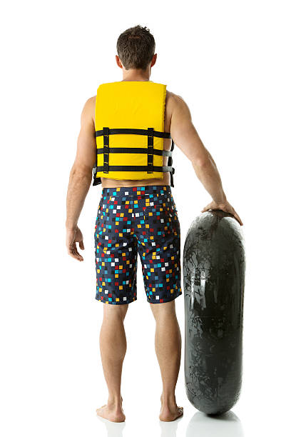 Man standing with inner tube stock photo