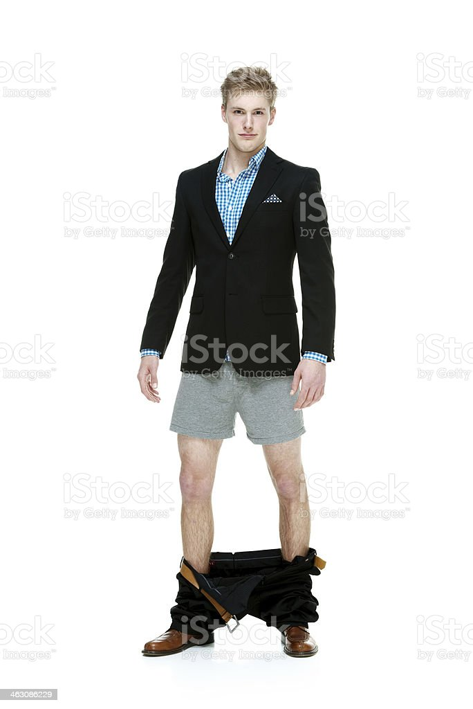 Man standing with pants down stock photo