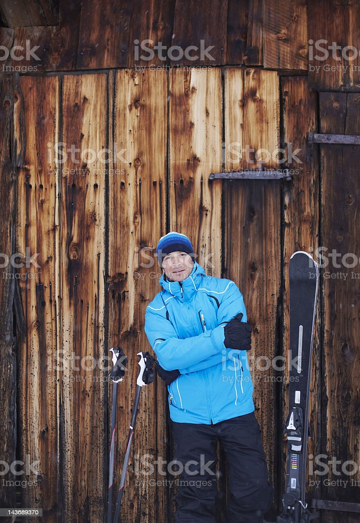 Man standing with skis and poles stock photo