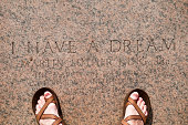 'Washington DC, USA - June 17, 2012: A man stands at the Lincoln Memorial, on the spot where Martin Luther King Jr gave his famous ''I Have A Dream'' speech on August 28, 1963.'