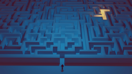 Concept of solving problems. Man stands in front of a big maze and is ready to enter it. There is light in the back of the maze.
