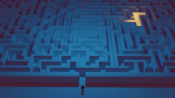 Man stands in front of a big maze ready to take on the challenge stock photo