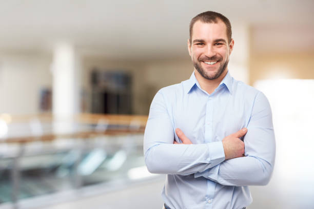 Man stands in the business center with crossed arms stock photo