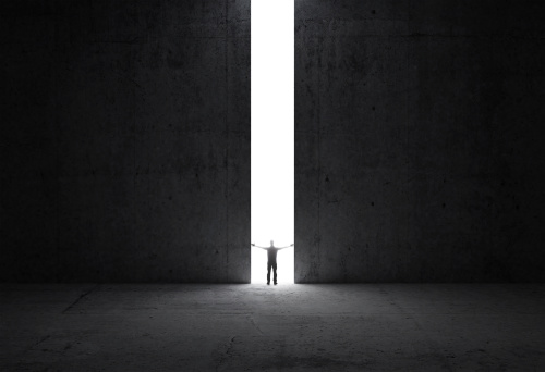 istock Man stands in the light of opening 180233152