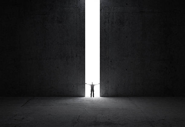 man stands in the light of opening - open gate stock photos and pictures