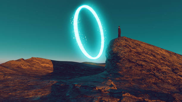 Man stands on top of hill looking into a portal created with neon light stock photo