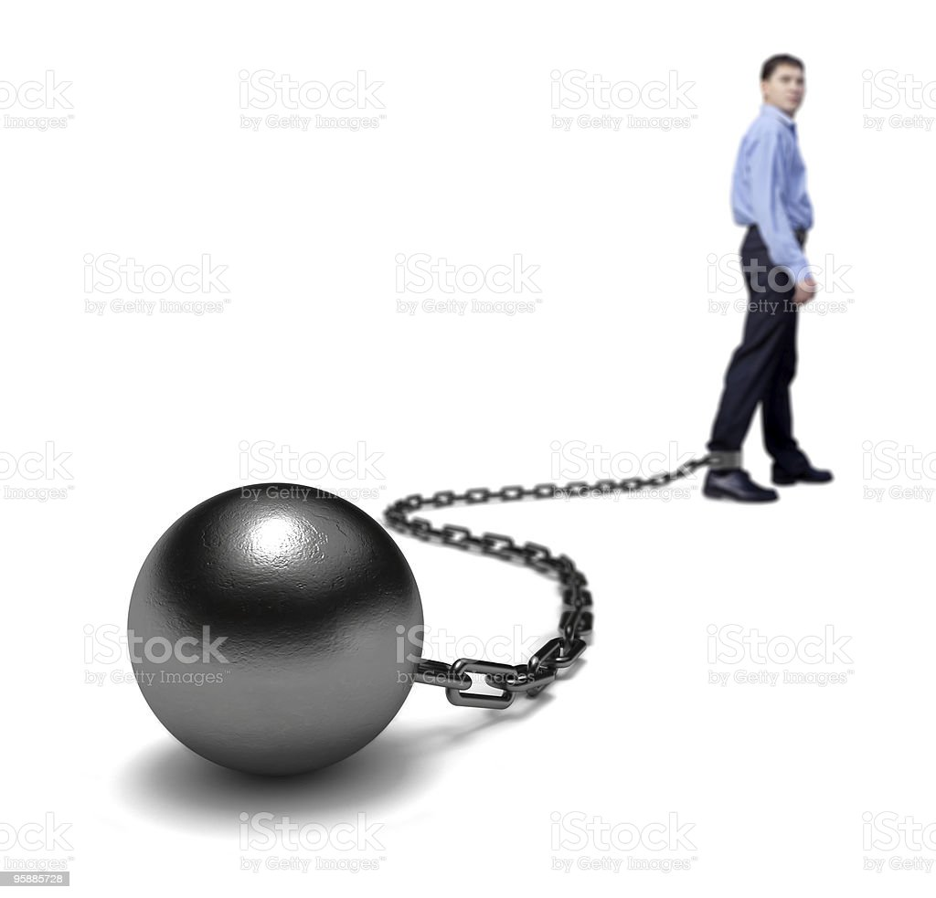 Man stands with a ball and chain on his ankle stock photo