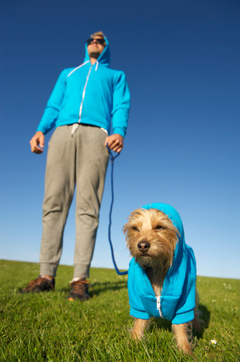 Man Stands with Dog in Matching Hoody Sweatshirt