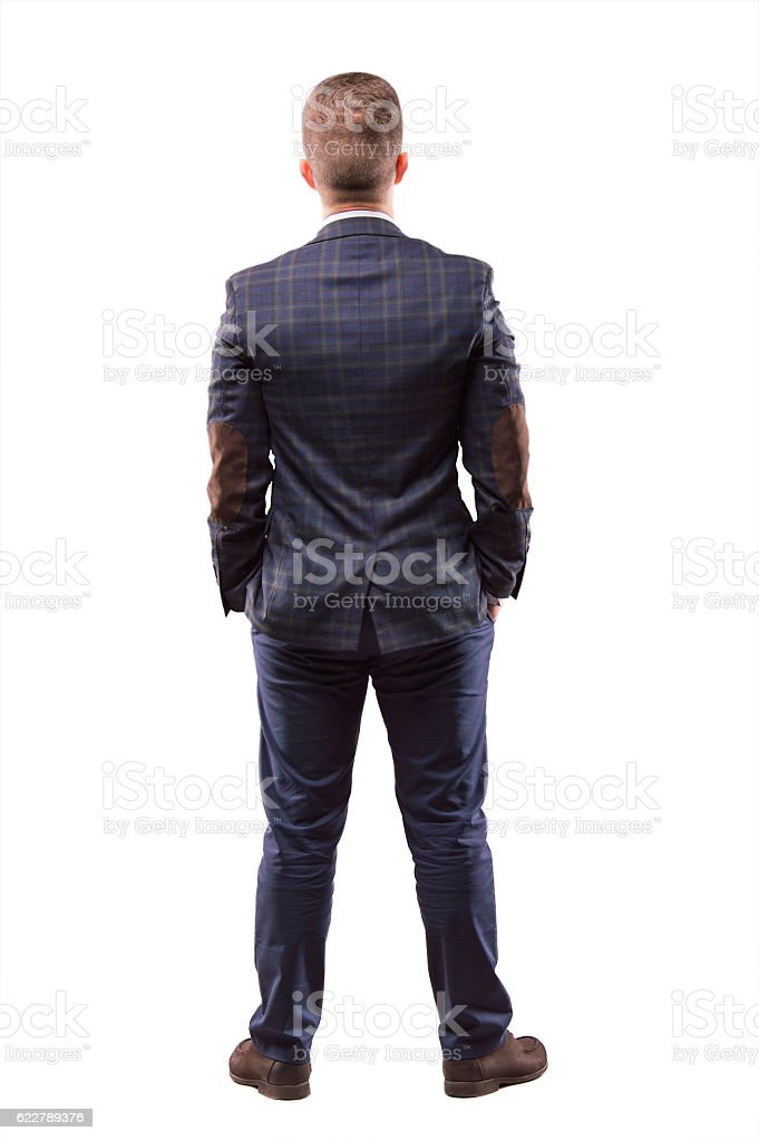 Man stands with his back to the camera stock photo