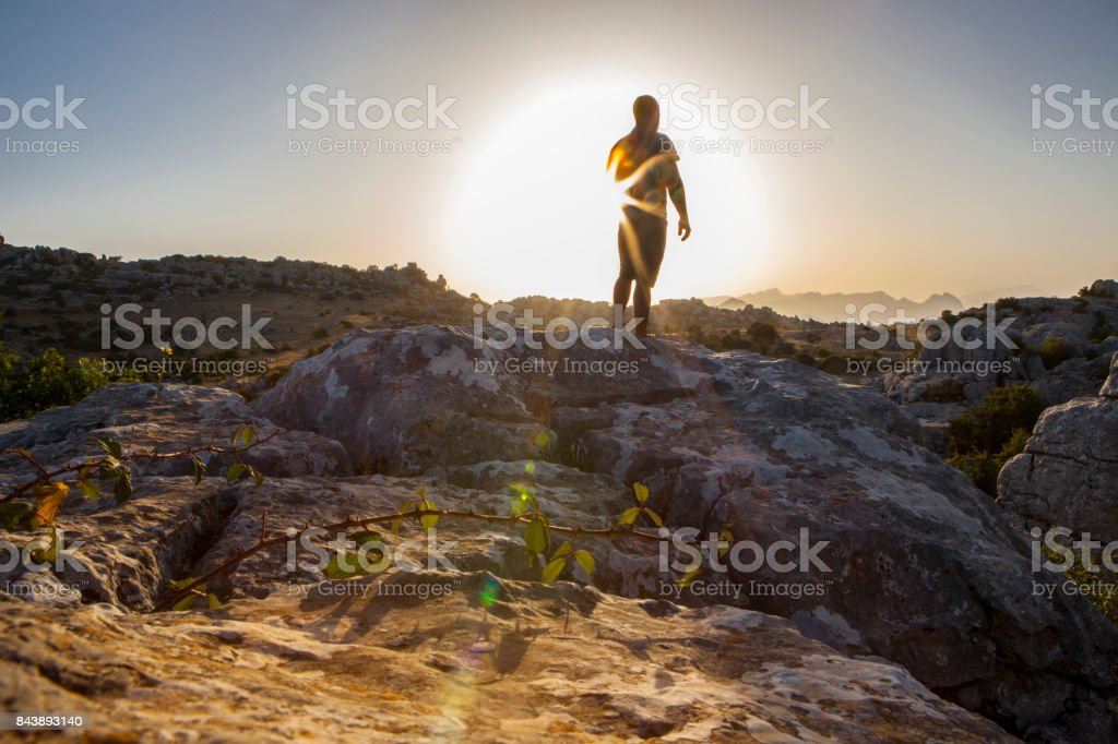 Man staring at sunrise. Torcal de Antequera, Spain stock photo