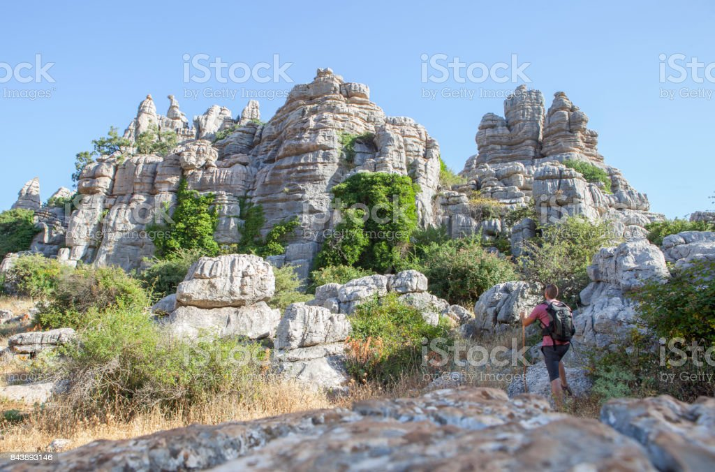 Man staring the impressive rock formations at Torcal de Antequera, Spain stock photo