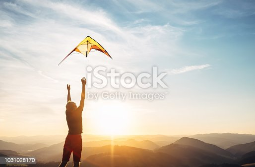 Man start to fly a kite in the sky