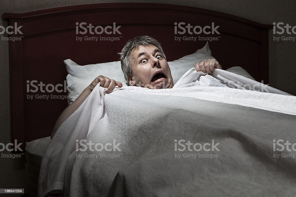 Man startled awake by intruder stock photo