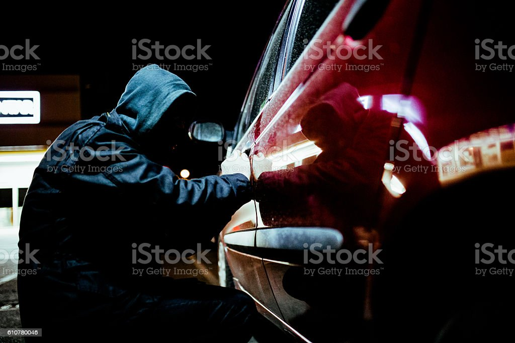 Man stealing a car stock photo