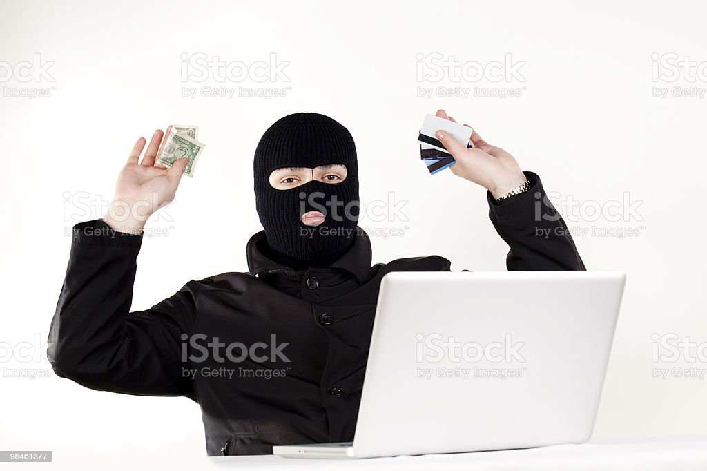 Man stealing data from a laptop royalty-free stock photo