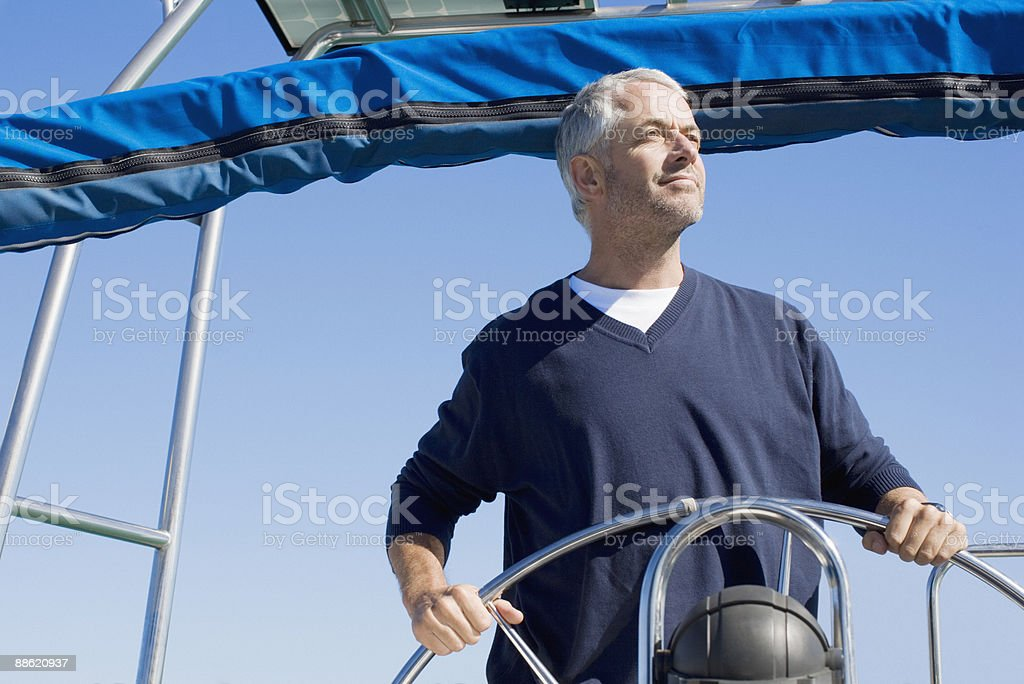 Man steering boat royalty-free stock photo