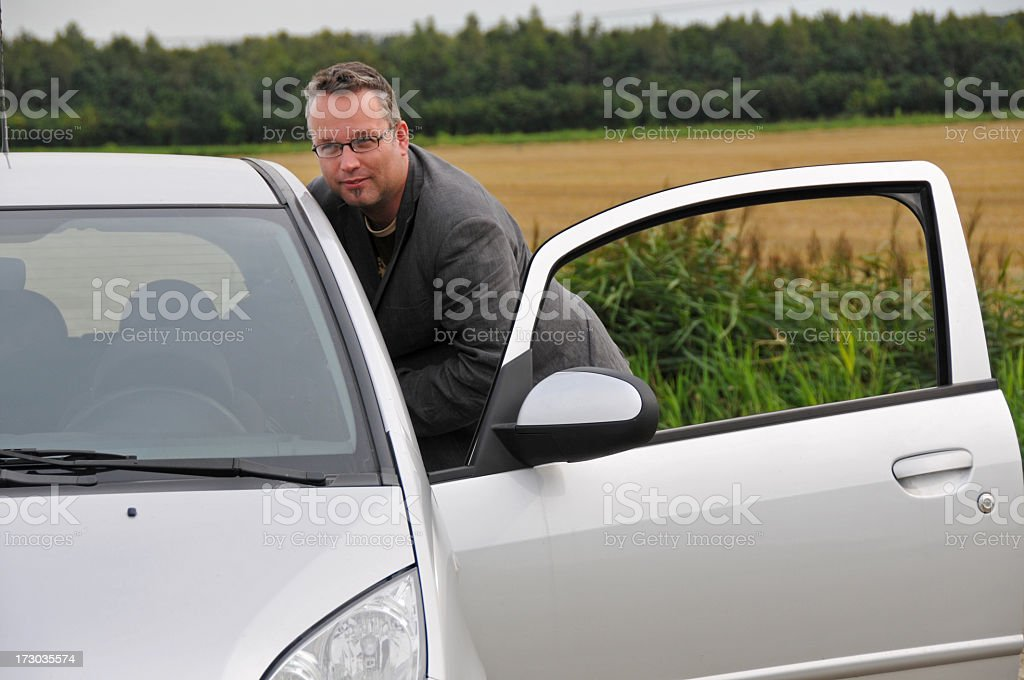 Man stepping into his car royalty-free stock photo