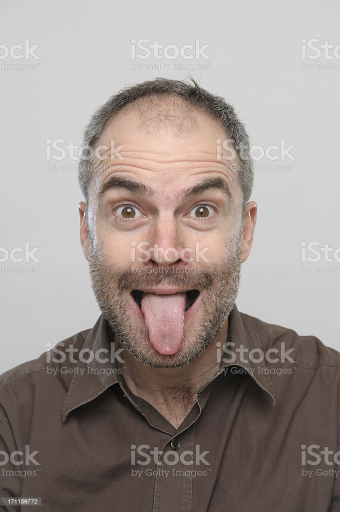 Man sticking out tongue stock photo