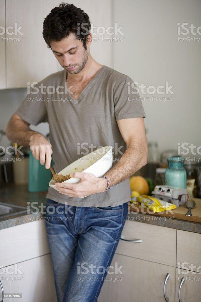 Man stirring cookie dough. royalty-free stock photo