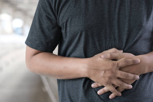 man stomach suffering and having a stomachache stock photo