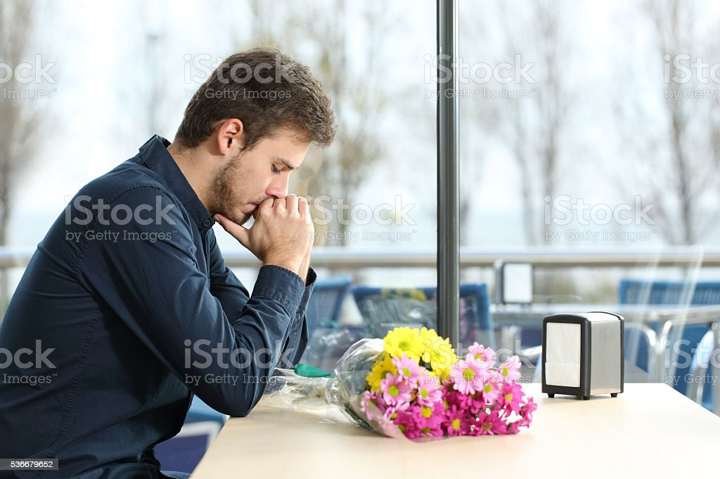 Man stood up in a date by his girlfriend stock photo