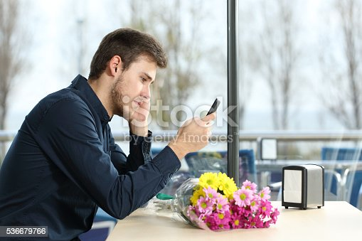 istock Man stood up in a date checking phone messages 536679766