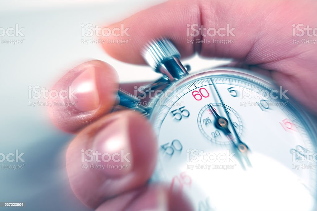 man stopping a stopwatch stock photo