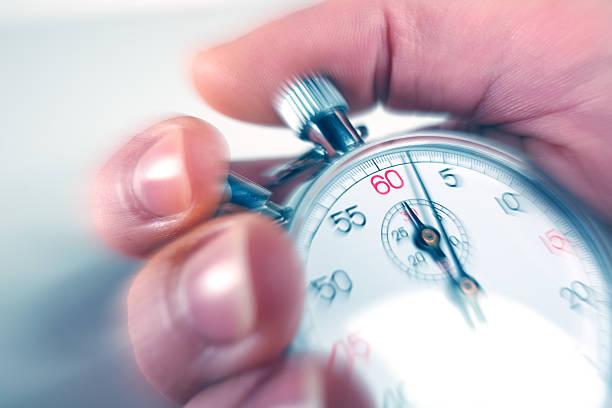 man stopping a stopwatch - stopwatch stockfoto's en -beelden