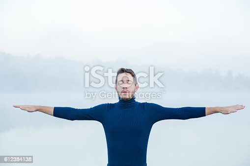 873786782 istock photo Man straightening arms and during meditation looking for balance. 612384138