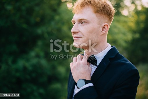 istock Man straightens bow-tie before the ceremony 836637170