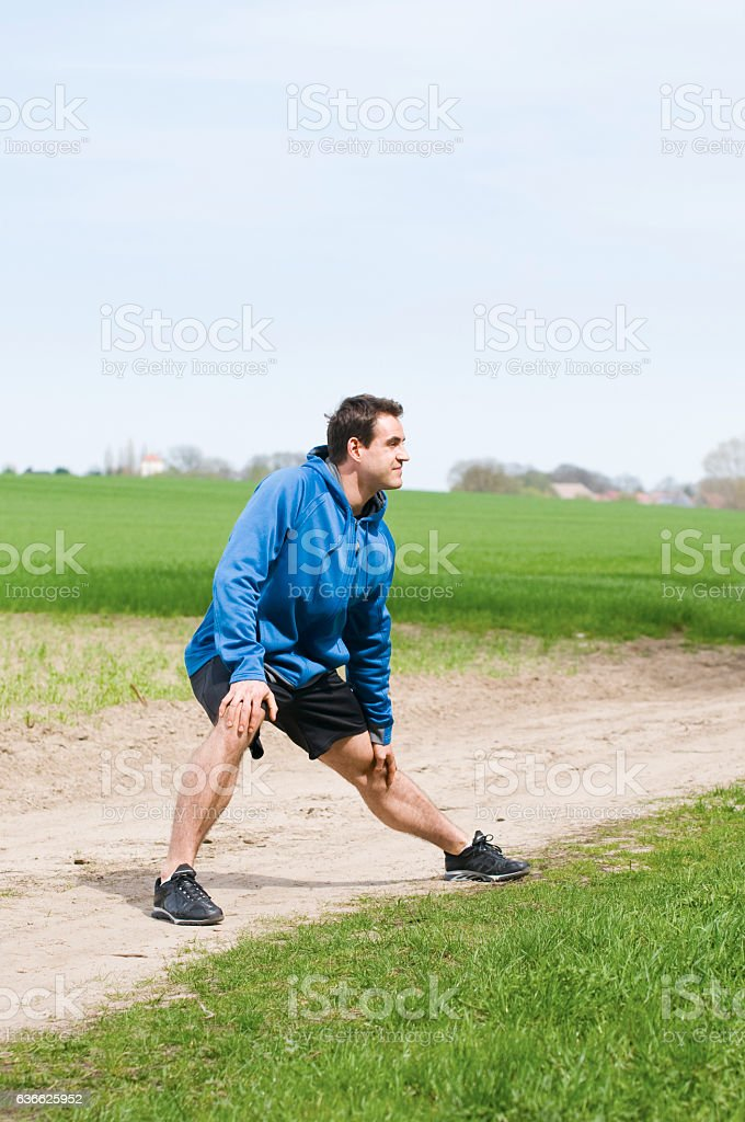 man stretch the left leg stock photo
