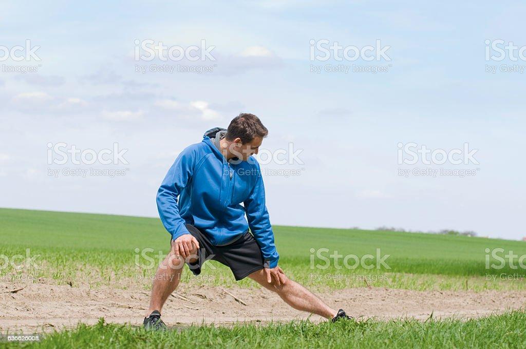man stretch the left leg_horizontal stock photo