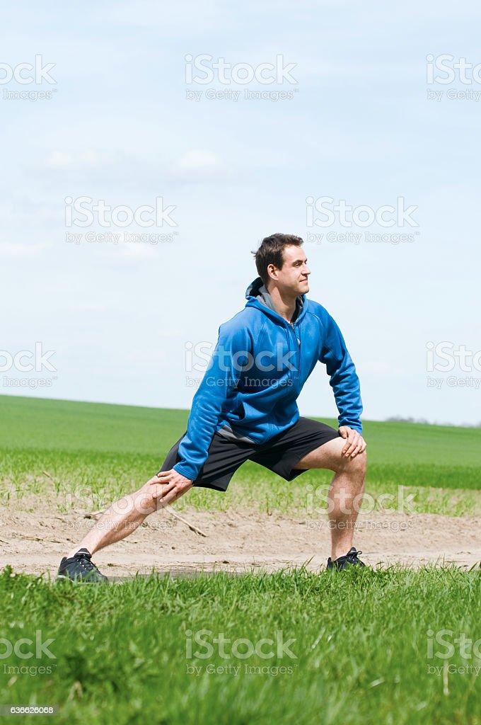 man stretch the right leg stock photo