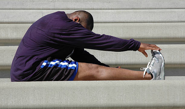 Man Stretches for Race stock photo