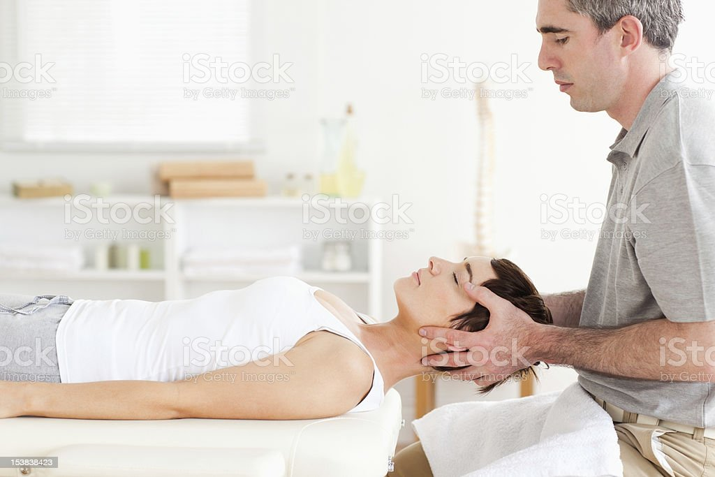 Man stretching a cute woman Man stretching a cute woman in a room Adult Stock Photo