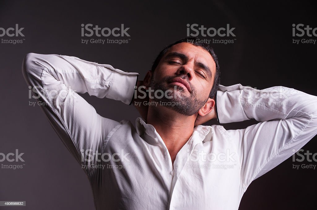 man stretching and relaxing stock photo