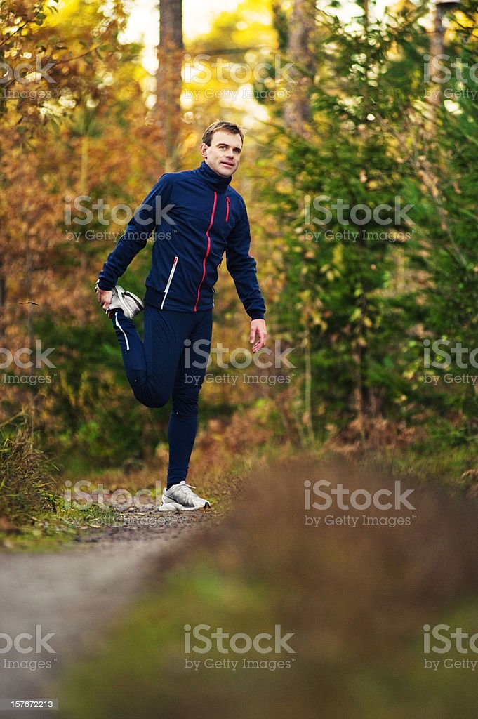 Man stretching - autumn trail royalty-free stock photo