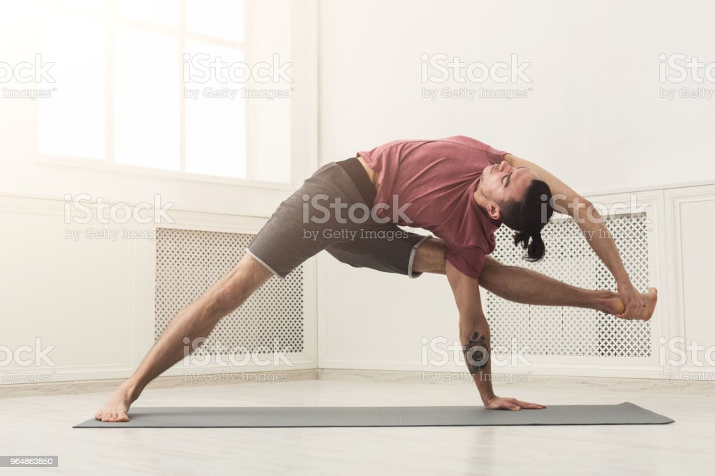 Man stretching back and legs at gym royalty-free stock photo