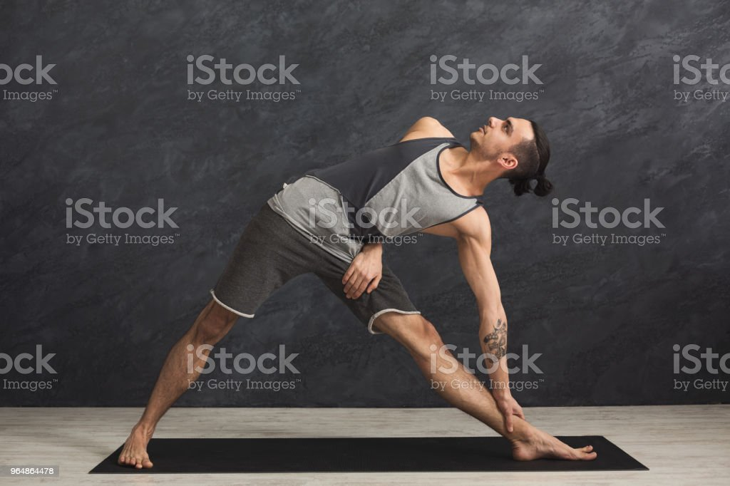 Man stretching hands and legs at gym royalty-free stock photo