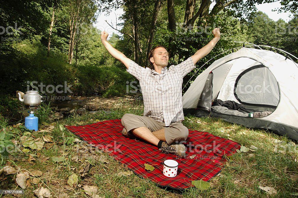 Man stretching in front of a tent - camping serie royalty-free stock photo