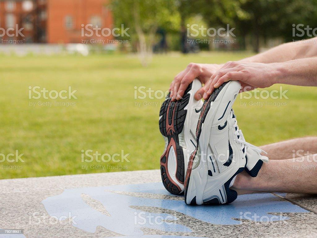A man stretching 免版稅 stock photo