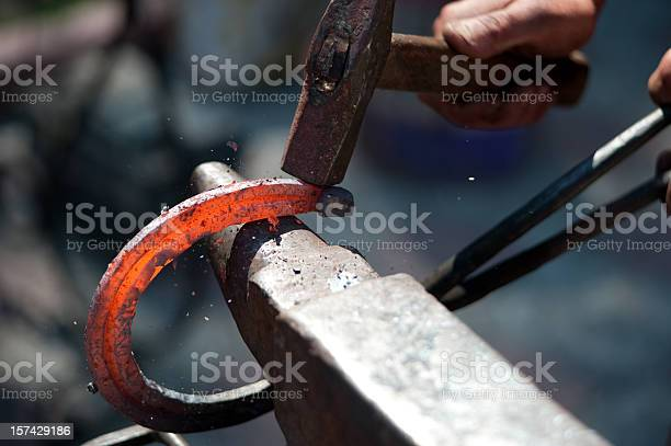 Man striking a red hot horseshoe on the anvil picture id157429186?b=1&k=6&m=157429186&s=612x612&h=sfbbtpfpaqkkxabwq1jfln77h9vfzblyhvfagkvnvs8=