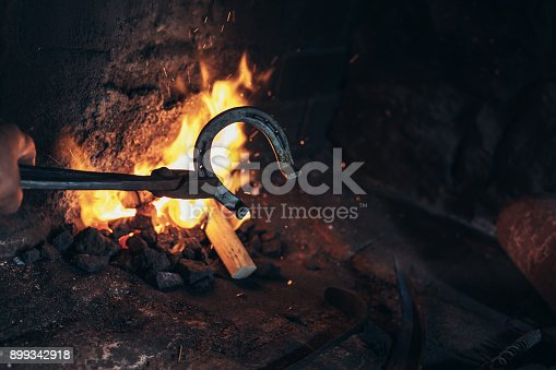 1130936245istockphoto A man striking horseshoe on the anvil 899342918