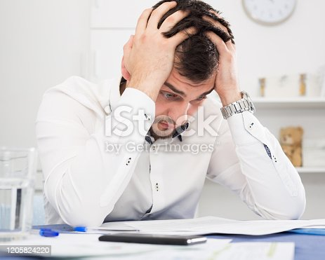Young distressed man having no possibility to pay utility bills and rent